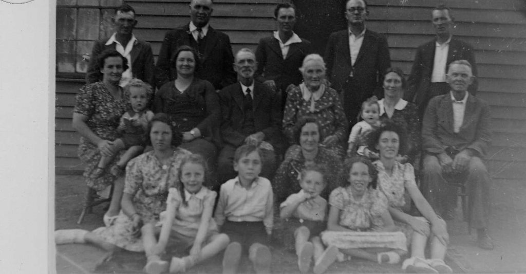 Back: L to R. Francis, Henry Irving, John Alexander, James Edgar, William Edmund Front: L to R. Nellie with John , ? John Noble James, Dorothy Atkinson, ? Walter and children.